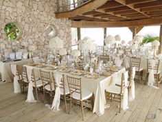 Jellyfish Restaurant Wedding decorated by Clara and Gianna. White and gold wedding. Orchids and hydrangeas. Tiffany chairs. Sashes on chairs. Beautiful!  www.barefootbridal.om