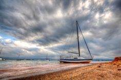 Clouds gather over the lake as this yacht makes its way to shore Multiple Exposure, Dynamic Range, Hdr, Shots, Clouds, World, Beach, Water, Photography