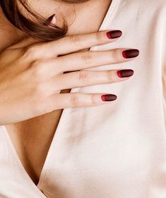 Take a spin on a traditional French manicure with reversed colors and a crisp, matte finish. Try opting for cool, complimentary hues like Paintbox'splum-and–blood red combo.