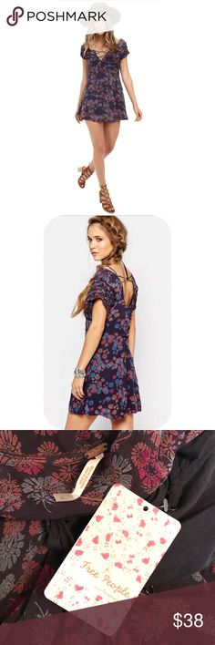 Free People printed boho mini dress - NWT Lightweight dress boasts feminine florals for an effortlessly chic look. V-neckline with lace-up detail. Short sleeve design. Deep scoop back with crossing strap at top. Concealed side zip closure. Straight hemline at a flirty length. Fully lined. 100% rayon; Lining: 60% rayon, 40% cotton. Free People Dresses