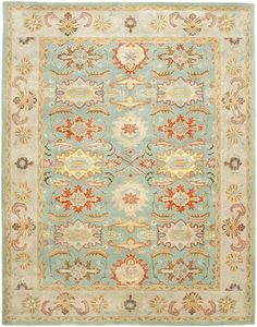 With rich, luscious detailing and a vibrant feel, Safavieh's Heritage collection brings life to any space. Hand-tufted of pure wool with strong cotton backing, these traditionally beautiful rugs can withstand even the most highly traveled areas of...