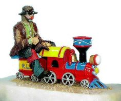 Emmett Kelly Jr I Know I Can Figurine. $159.99. Emmett is riding the train in the Annual Clown Parade on Main Street. This figurine is limited to only 1500 pieces. Each Emmett Kelly Jr figurine is made of pewter, hand painted, comes mounted on an onyx base and is signed by the artist Ron Lee. All of the Ron Lee Emmett Kelly Jr sculptures are Made in the USA. #EmmettKellyJr #Clowns #Clown #Emmett