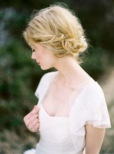 looking away  soft and pretty portrait; peasant messy hair updo
