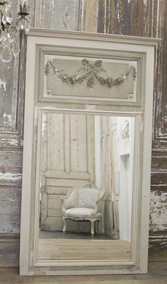 SKU Number: 55095-T1 Description: This stunning tremeau mirror is one of our favorites! Original roses carvings, and french grey green paint.