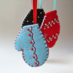 Ornaments - felt mittens in red, brown & blue holiday decor. $34.00, via Etsy.