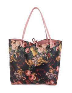 Izmir bag. An eyecatching shopper with black base floral print and colored handles and straps is perfect for this summer. Grocerier, beachwear and books - it fits it all! #loveisessentiel