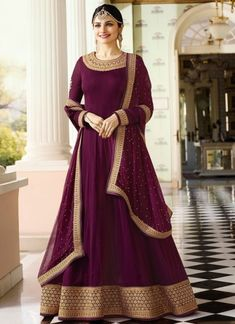 Bollywood diva prachi desai wine partywear anarkali suit online which is crafted from georgette fabric with exclusive embroidery and stone work. This stunning designer anarkali suit comes with santoon bottom, santoon inner and chiffon dupatta.