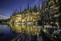 athanbaska river reflection - Near Athabaska Falls there are wonderful canyons and the Athabaska river River. Here near sunset I captured nice light and a terrific reflection by going low to the water.