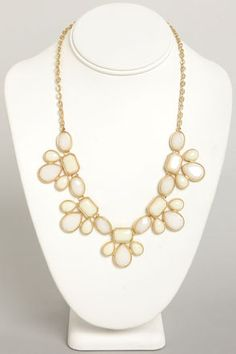 Cream statement necklace to be paired with coral dress.