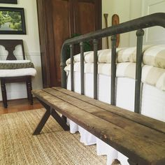 rustic bench at the end of the bed <3 love this farmhouse bedroom