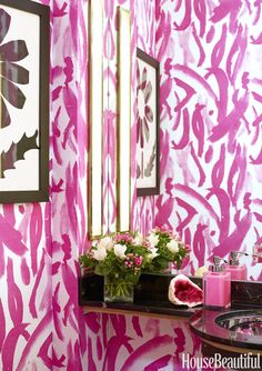 Upholtsered powder room/batharoom walls in custom coloured hot pink Amanda Nisbet's fabric