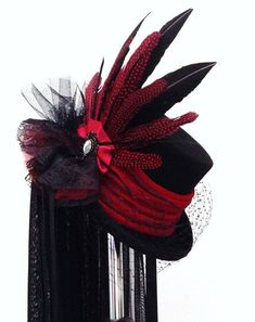 http://cdn.gothic.life/wp-content/uploads/2015/05/Gothic-Victorian-Raven-black-red-wedding-hat.jpg