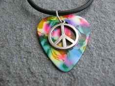Guitar Pick Necklace Peace Symbol on Rainbow Pick Unique Design By Atlantic Seaboard Trading Co. by Atlantic Seaboard Trading Co.. $9.99. Guitar Pick Necklace Peace Symbol on Rainbow Pick Unique Design By Atlantic Seaboard Trading Co.