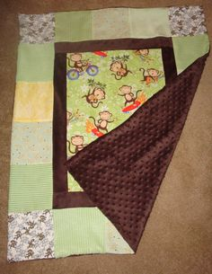 Front and back of monkey blanket: Don't  like monkeys but this would make a quick donation baby quilt from my stash.