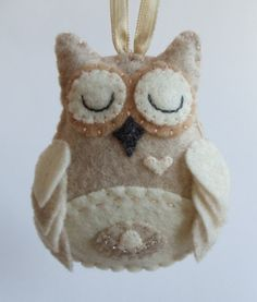 This cutesy little owl was hand stitched and embroidered using oatmeal, ivory, and tan felt