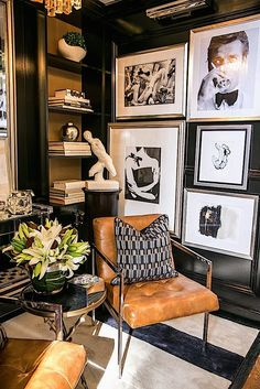 A very masculine vignette with the black and white images, all framed in silver tone mouldings, glossy black walls and weathered leather upholstery. Thanks to the white mats used on each piece of custom framed art, they stand out in this stunning space.
