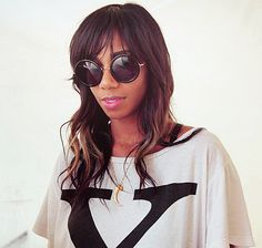 """Santigold - LOVE HER!  Check out the youtube video of her concert:  """"Sasquatch music festival 2009 - Guy starts dance party"""" .. wait for it.."""