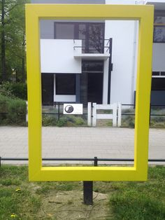 Open Yellow National Geographic Frame in front of Rietveld-Schröder House. #DeStijl