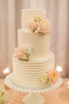 A gorgeous cake on a pretty milk glass cake stand.