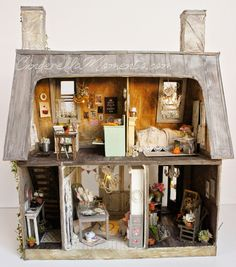 "Here's a look at my newest dollhouse - ""Un Immeuble a Paris""    It has 2 shops and the entry to the upstairs apartment on the lower part. An..."