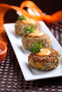 Crab Cakes, made vegan—farro is subbed in place of crab for a flaky bite.