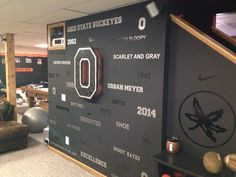 Buckeyes man cave wall. Subway style with backlit block O with ghosted buckeye leaves.