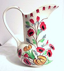 This is a pretty pitcher made by Blue Ridge -Southern Potteries. The shape is called Jane and the pattern is Scatter. This pitcher stands 7.5 inches tall and is marked on the bottom. It is in very nic