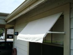 And there is a $20 awning. It took me about an afternoon to make, if you don't count the trip to the store. What to change, depending on how long you want the awning to last: - Use a mildew-resistant cloth. The drop cloth mildewed after a month or so. I sprayed some dilute bleach solution, and that helped, but I think I waited too long. (The bleach also probably accelerated the corrosion of the carpet tacks.) I live in a hot & humid climate; if you live in a hot & dry climate this may not be…