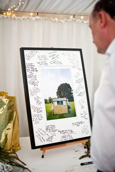 Alternative guest book - signed wedding photo. Graham Young Wedding Photography http://www.grahamyoungphotos.co.uk/