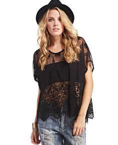 """<p>With a flowy oversized style, this chic blouse lends itself to a boho-inspired appeal. The top part of the blouse features a sheer mesh fabric with gorgeous floral embroidery, the bottom is made with floral crochet and has a scalloped hem. The top also has a scoop neckline, short dolman sleeves, and a relaxed fit. Unlined.</p>  <p>Model is 5'9"""" and wears a size small.</p>  <ul> <li>60% Cotton / 40% Nylon</li> <li>Hand Wash</li> <li>Imported</li> </ul>"""