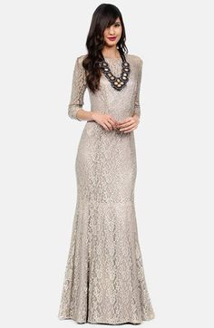 gorgeous nude toned / taupe colored three-quarter sleeve lace maxi dress | nude toned lace gown | long-sleeved lace gown | trumpet shape | high-neckline | worn with a gorgeous statement necklace and bold lip | Kay Unger Lace Gown | Nordstrom