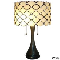 <li>Illuminate your home's interior with this jeweled table lamp</li> <li>Tiffany-style lighting features a beautifully crafted base and neutral shade with hues</li> <li>Unique barrel-shaped lamp will bring brilliant elegance to your home decor</li>