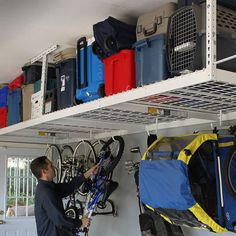 This overhead garage storage rack fits nearly any garage and features a full 600 pound capacity and adjustable distance from the ceiling of 12 to 45 inches. Overhead Storage Rack, Garage Storage Racks, Garage Organization Systems, Garage Storage Solutions, Wall Organization, Storage Ideas, Storage Systems, Tool Storage, Storage Shelves