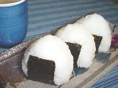 Onigiri (Japanese Rice Balls) from Food.com:   Like Nori rolls but triangular.
