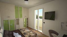 Camera da letto con balcone di appartamento in vendita a Cattolica (RN).