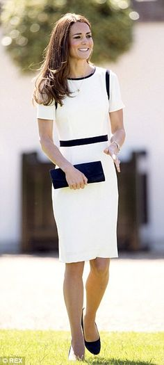 Classic Kate is shipshape at the National Maritime Museum in a navy and white dress by British stalwart Jaeger