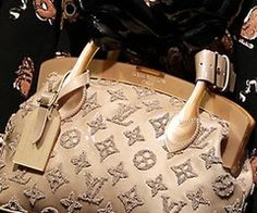 I am in total lust for the new embroidered LV bags.