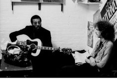 Richie Havens and Eric Clapton.