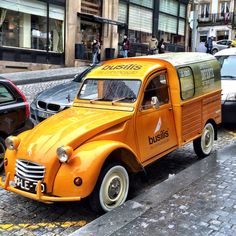 Citroen 2cv AZU fourgonette photographed in Porto in front of a shop.