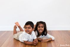 Gorgeous kids hanging out on the floor with big smiles in these Lifestyle Photos at Home