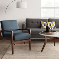 Full of handcrafted mid-century modern style, the Peoria Wood Arm Chair from Project provides a stylish accent to any room. This upholstered arm. Coffee Table Stand, Modern Coffee Tables, Modern Chairs, Wood Arm Chair, Upholstered Arm Chair, Blue Armchair, White Table Top, Living Room Update, Furniture Legs