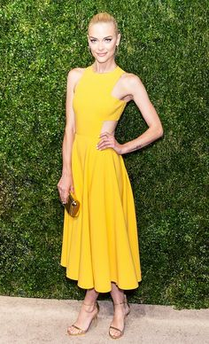 Jaime King in a yellow dress and gold sandals