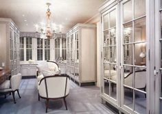 #WhiteCloset Luxury.  I love the mirrored doors and seatee in the middle.  Gorgous closet for a #Diva.  Glamorous #make-up area.  I love designing custom closets like this.  Do you have a crystal chandelier in your closet?