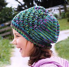 A relaxed slouchy hat perfect for showcasing colourful hand-dyed and artisan yarns. #diagonalstitch #aranyarn #slouchhat
