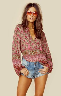"""Spell's Kombi Blouse features an exclusive boho print throughout, long flare sleeves, partial button front, and tassel ties at the neckline.   ImportedDry Clean Only100% RayonFit Guide:Model is 5ft 7 inches; Bust: 34"""", Waist: 25"""", Hips: 35""""Model is wearing a size XSRelaxed FitShoes Featured Not Available For Purchase"""