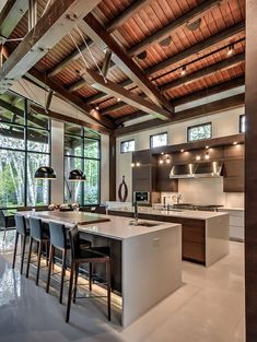 Clean Lines & Serious Style in Alberta, Canada This modern mountain design blends age-old timber frame construction with contemporary angles. Modern Kitchen Interiors, Modern Kitchen Design, Interior Design Kitchen, Kitchen Contemporary, Modern Design, Contemporary Cabinets, Kitchen Counter Design, Contemporary Windows, Modern Kitchen Lighting