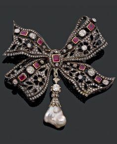 An antique gold, silver, diamond, ruby and pearl bow brooch, 19th century. 8cm wide. #antique #brooch