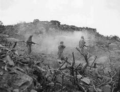 Four US Marines cleared out a cave with BAR small arms and grenades Iwo Jima circa February-March 1945.
