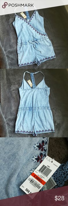 FLASH SALE!!! American Rag Jean romper NWT Beautiful American Rag Jean Romper. NWT. I have 2 sizes. XS and Med. Super cute knit back detail. Clinches at waist. Cute embroidery details. American Rag Shorts