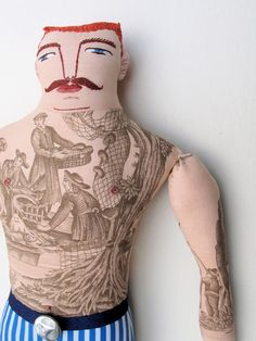 An art doll from Mimi Kirchner.  Mimi's work is so thoughtful and well-crafted.  All her dolls are so clever, but this is my favorite-- I love how she brilliantly took the printed fabric and turned it into a tattoo for the tattoo man of cours!